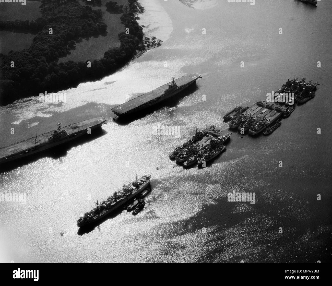 Royal Navy aircraft carriers and other military ships on the River Tamar, Plymouth, Devon, 1959. Artist: Harold Wingham. - Stock Image