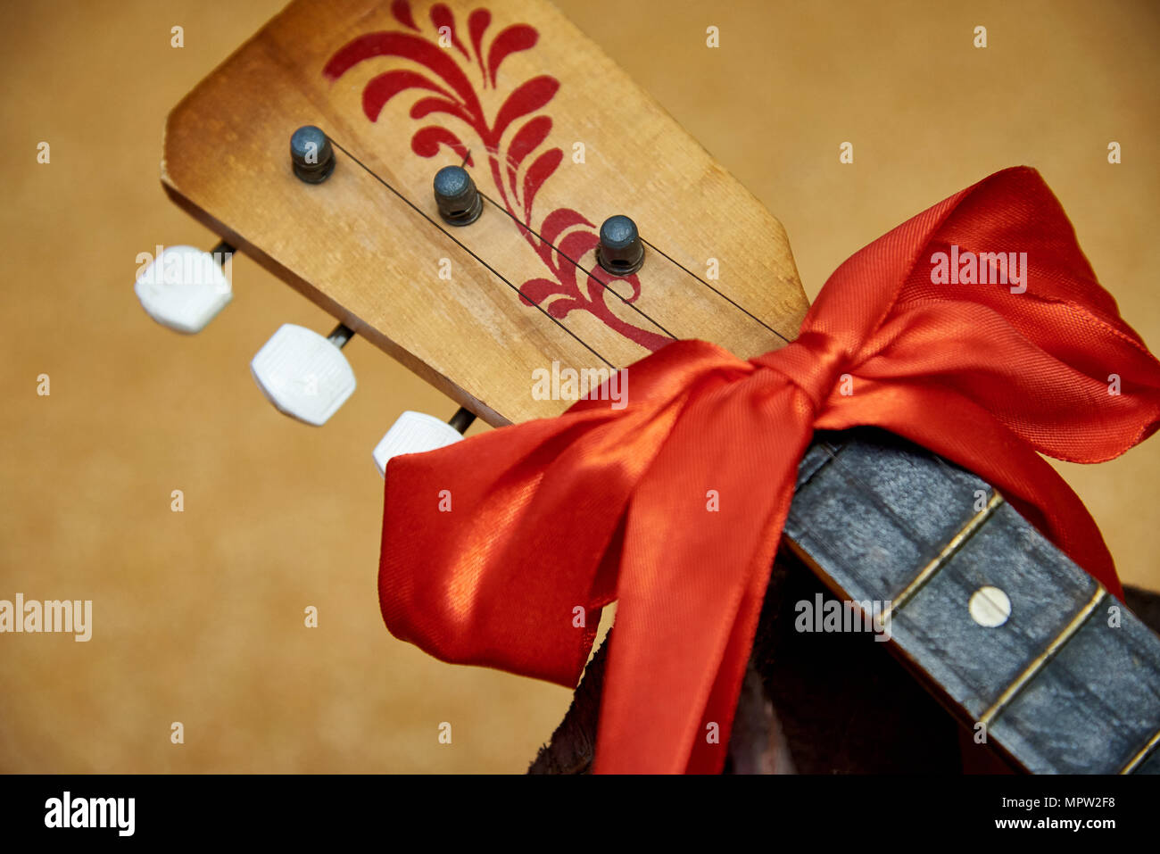 Russian balalaika with bow close-up - Stock Image