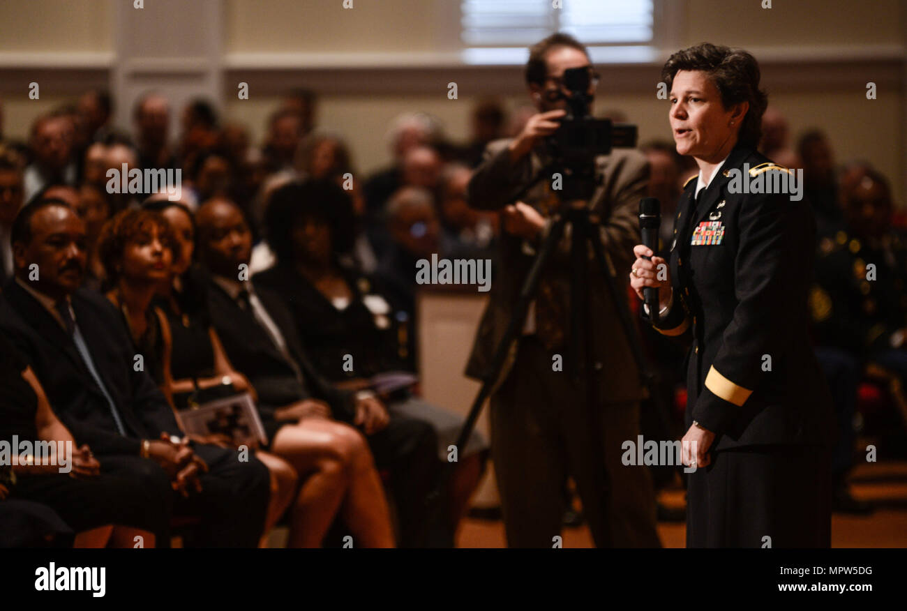 Army Brig. Gen. Deborah L. Kotulich, commanding general, 143d Sustainment Command (Expeditionary), expresses her condolences to the hundreds of friends, families and service members gathered to pay their respects to Army Maj. Gen. Francisco A. Espaillat during a memorial service conducted April 14, 2017, at the First United Methodist Church in Oviedo, Fla. Espaillat, who died April 7, served as the commanding general of the 143d ESC from 2014-2016 before transferring to Ft. Bragg and accepting his final assignment as the chief of staff for U.S. Army Reserve Command. (U.S. Army photo by Sgt. Jo - Stock Image