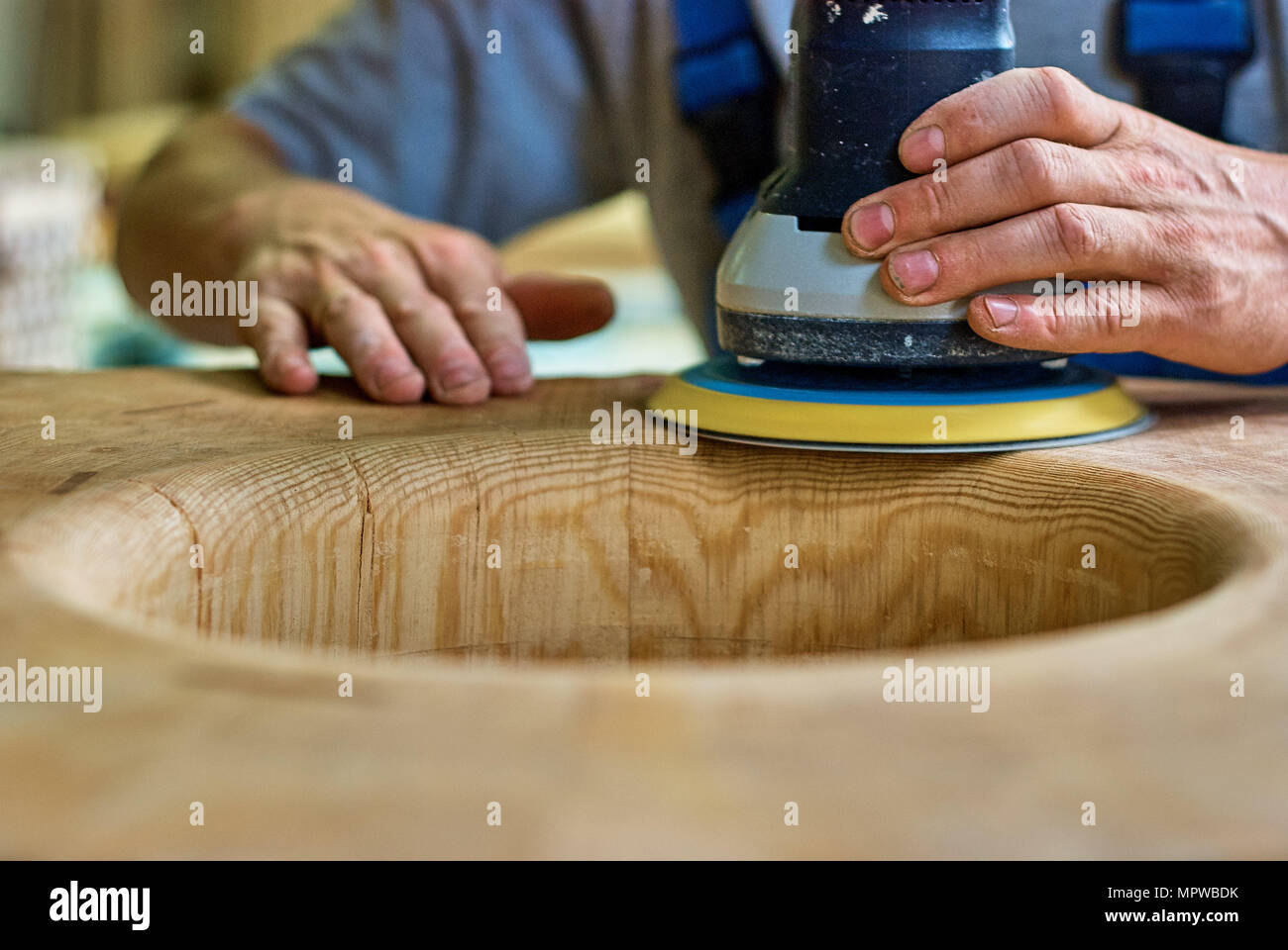 Woodworker is laboring carefully with professional equipment - Stock Image