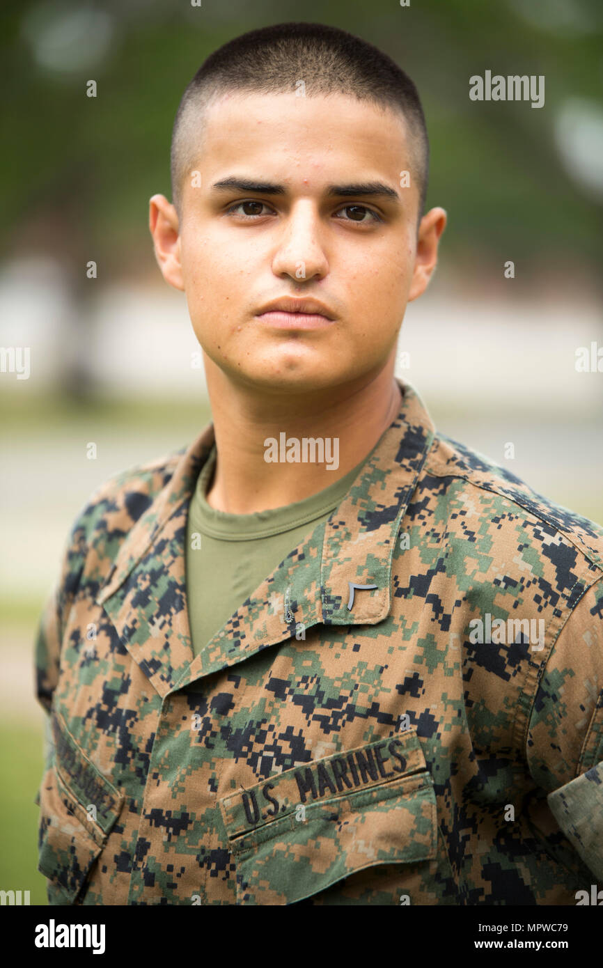 Pfc. Bryan Zurita Velasquez, Platoon 3029, India Company, 3rd Recruit Training Battalion, earned U.S. citizenship April 20, 2017 , on Parris Island, S.C. Before earning citizenship, applicants must demonstrate knowledge of the English language and American government, show good moral character and take the Oath of Allegiance to the U.S. Constitution. Zurita Velasquez, from , originally from Ecuador, is scheduled to graduate April 21, 2017 . (Photo by Cpl. Aaron Bolser) - Stock Image