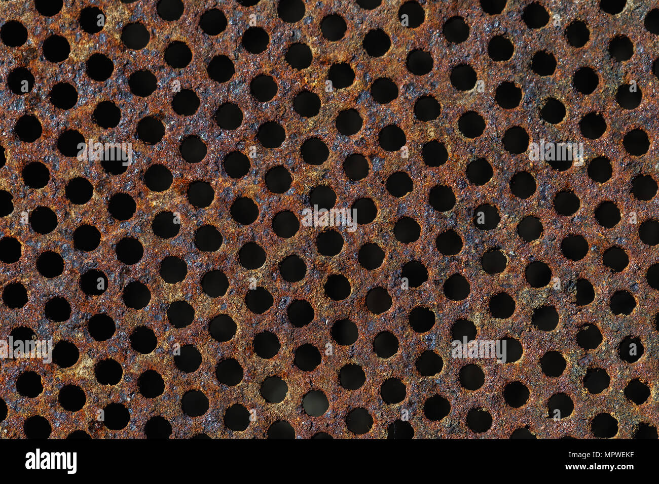 Texture of a rusty metal grid, closeup - Stock Image