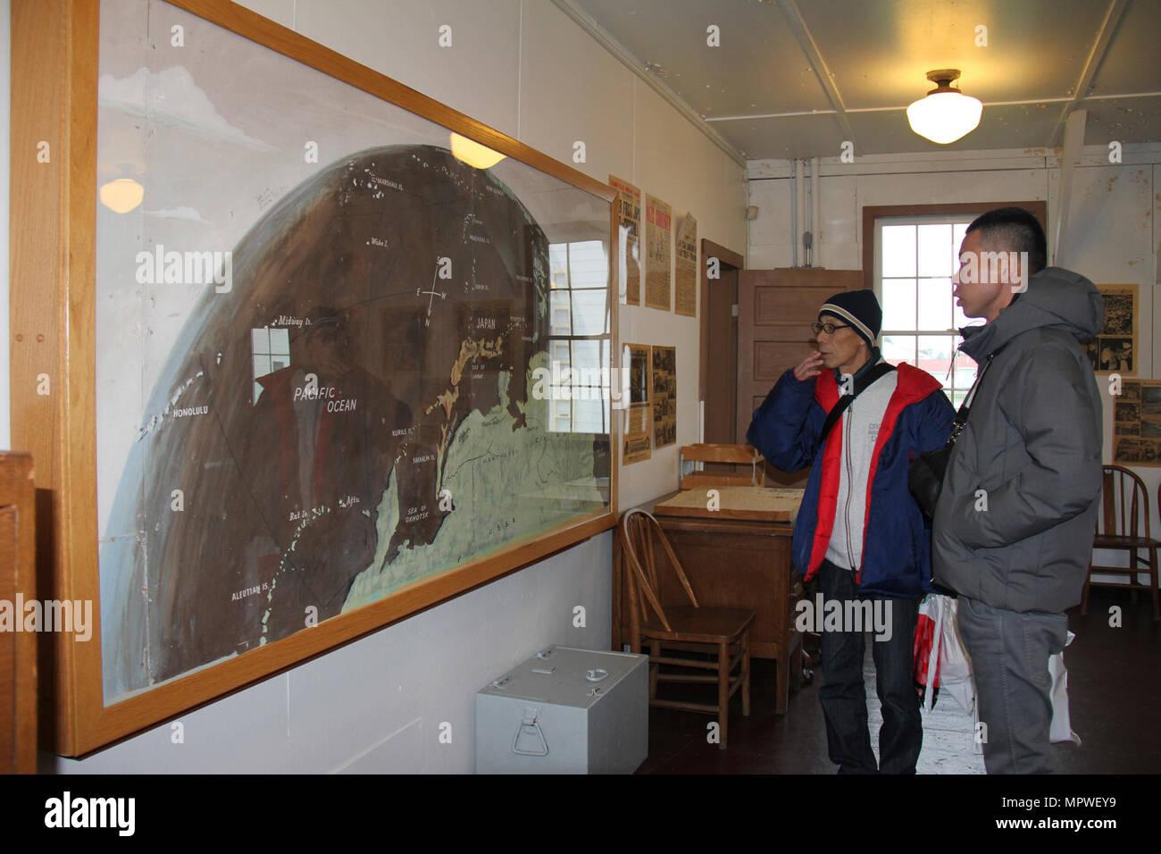 Shinji ichiyanagi left and his nephew takashi minda look at a map shinji ichiyanagi left and his nephew takashi minda look at a map painted during world war ii by a japanese prisoner of war held at camp mccoy gumiabroncs Images