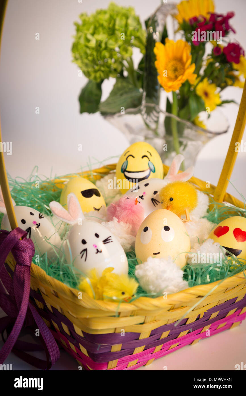 Basket of Hand Decorated Easter Eggs and Bunnies, USA Stock Photo