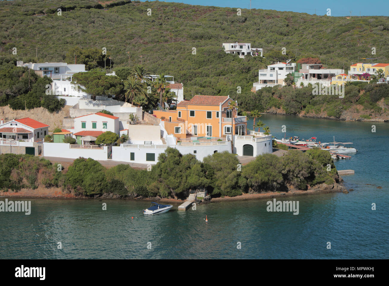 Sea gulf and country houses ashore. Mahon, Menorca, Spain - Stock Image