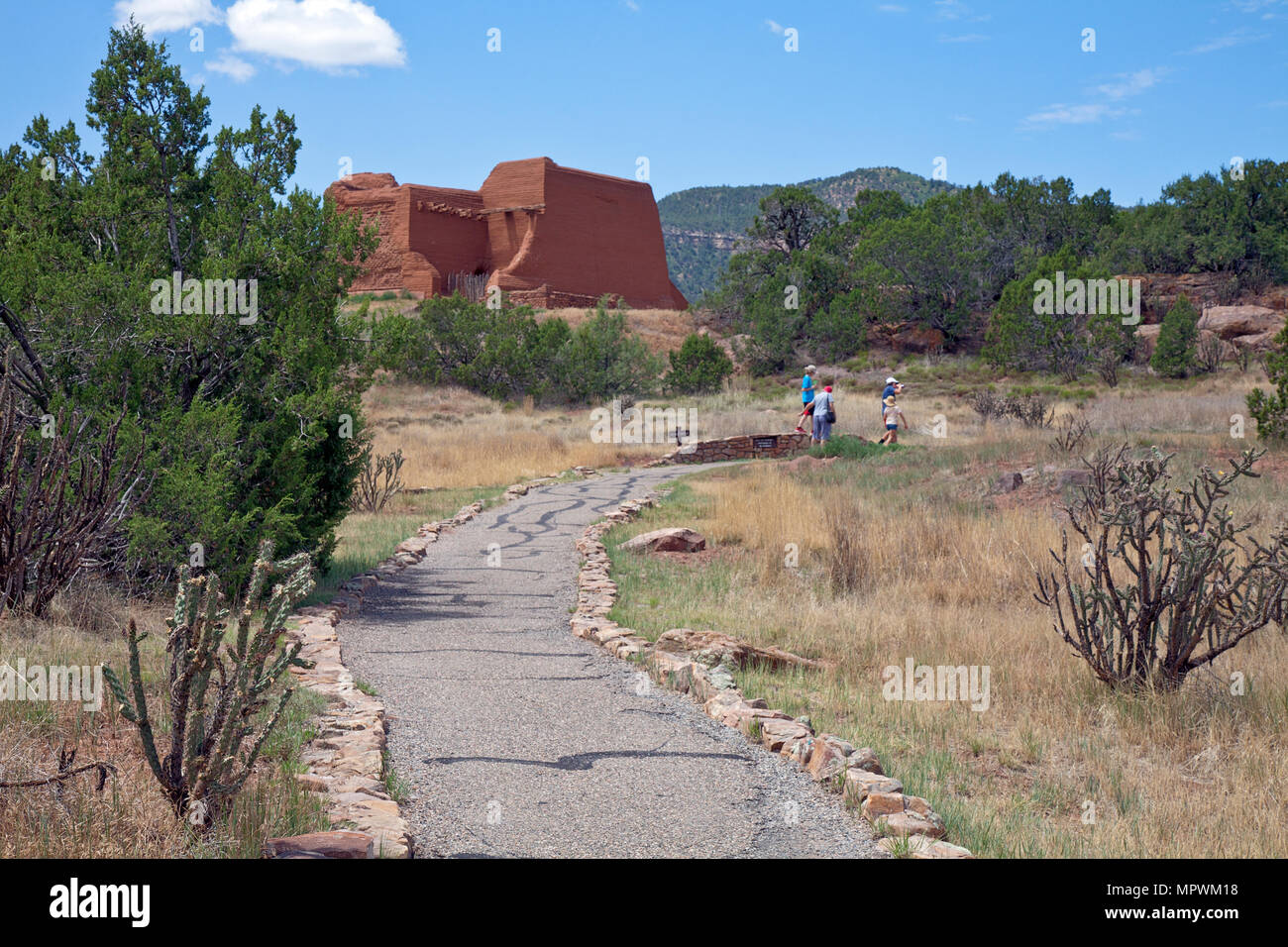 A family follows the Missions Ruins Trail at Pecos National Historical Park in San Miguel and Santa Fe counties, New Mexico. Day trip from Santa Fe. - Stock Image
