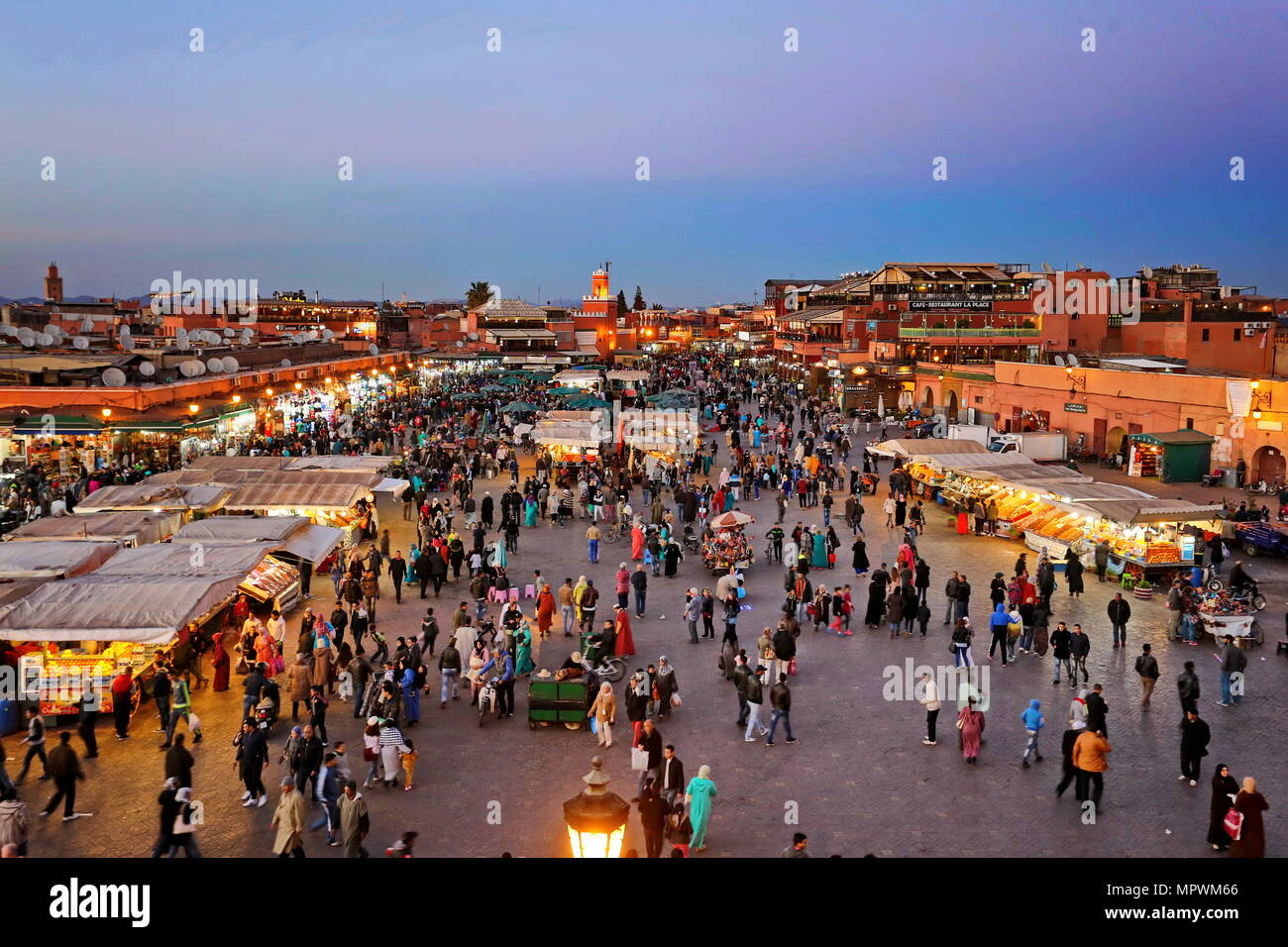 MARRAKECH, MOROCCO - 7 March 2016: Famous Jemaa el Fna square crowded at dusk. Marrakesh, Morocco Stock Photo