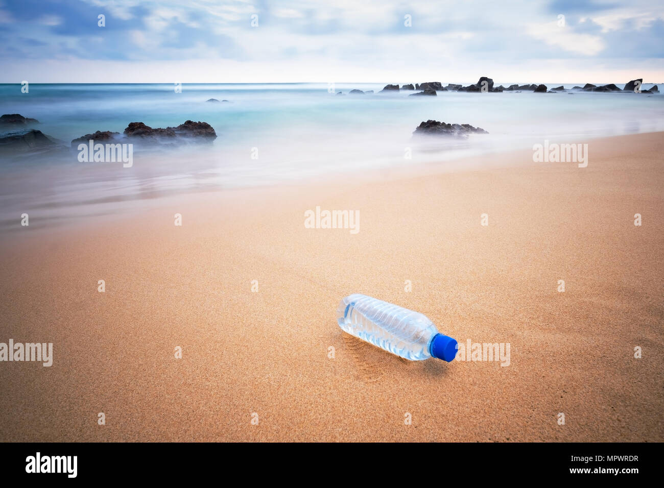 Plastic bottle on the beach. - Stock Image