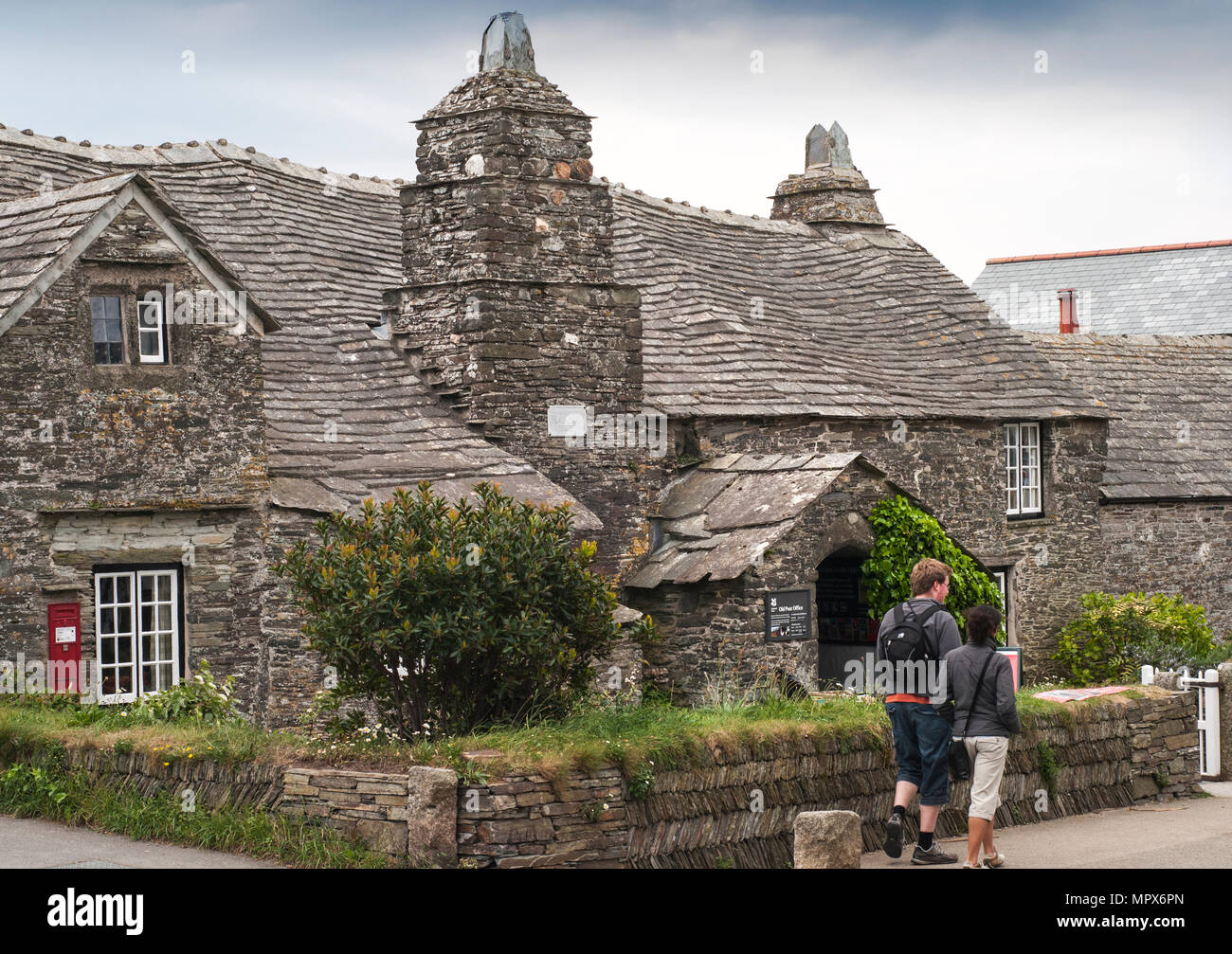 The old post office at Tintagel in Cornwall, England, UK. The 14th century stone house was built to the plan of a medieval manor house. - Stock Image