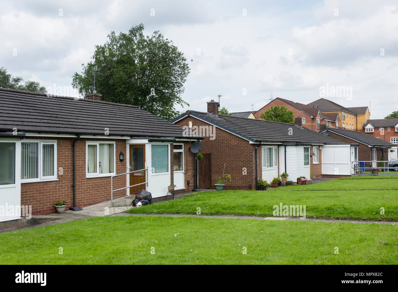 Bungalows in Walkden, Greater Manchester. Late 20th century build bungalows, some adapted to give disability ramps level access with handrail. - Stock Image