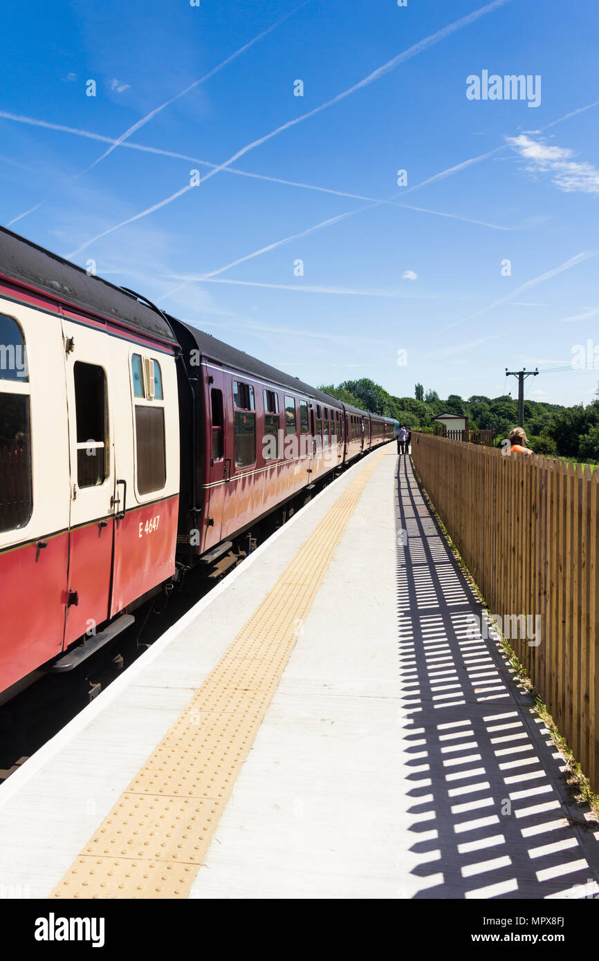 Passenger train, hauled by Class 45 'Peak' diesel 45108, at Burrs Country Park station on the East Lancashire Railway. - Stock Image