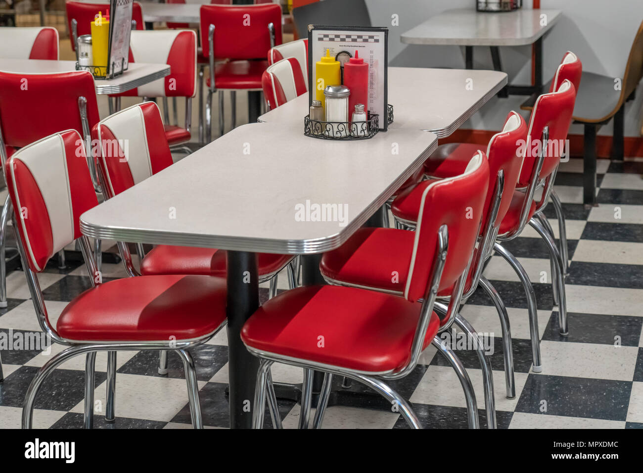 50s style diner with black and white tile floor red vinyl chairs and laminate and chrome tables & 50s style diner with black and white tile floor red vinyl chairs ...