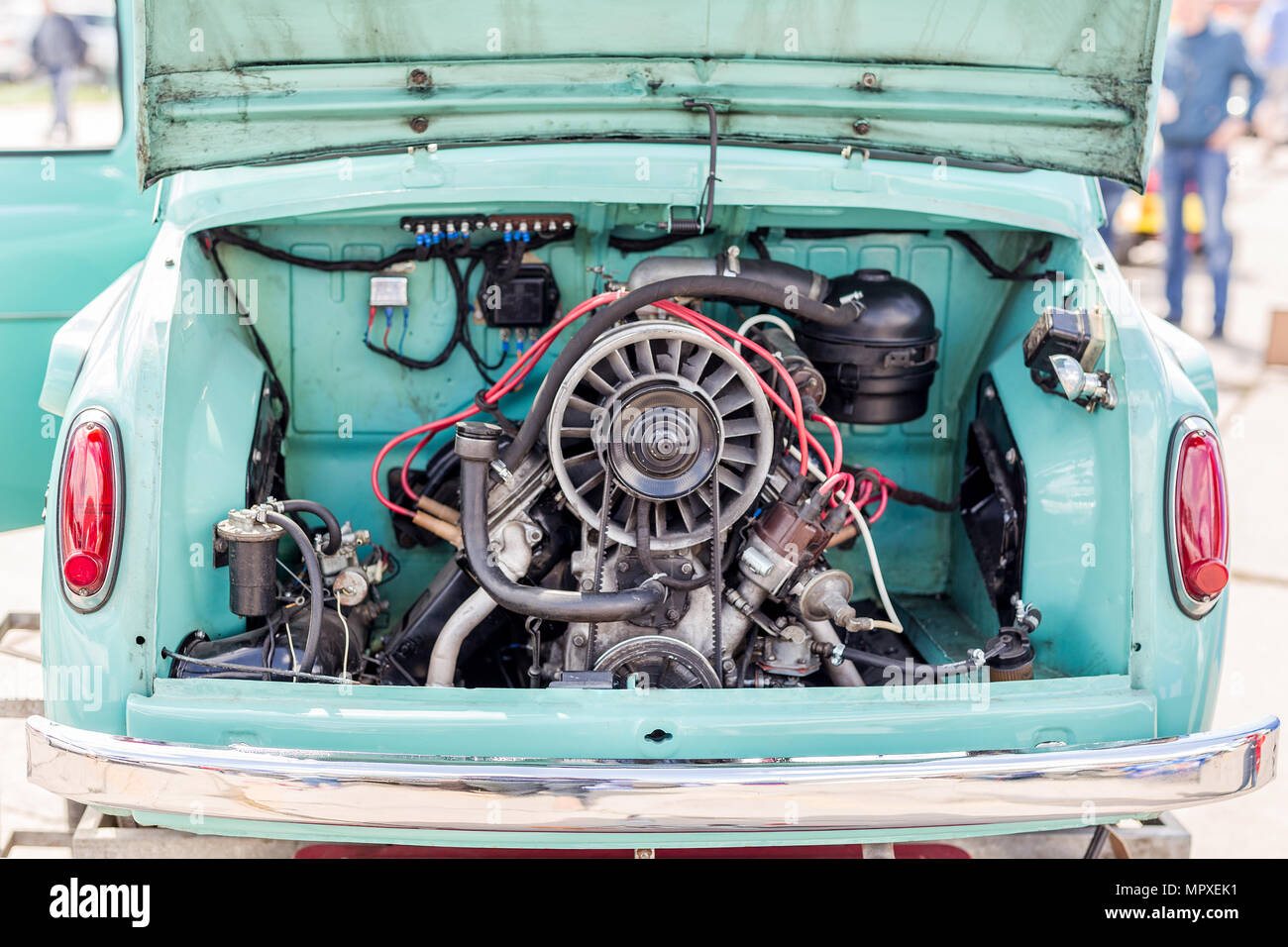 Back view of vintage retro car with open trunk. Rear-engined old vehicle. - Stock Image