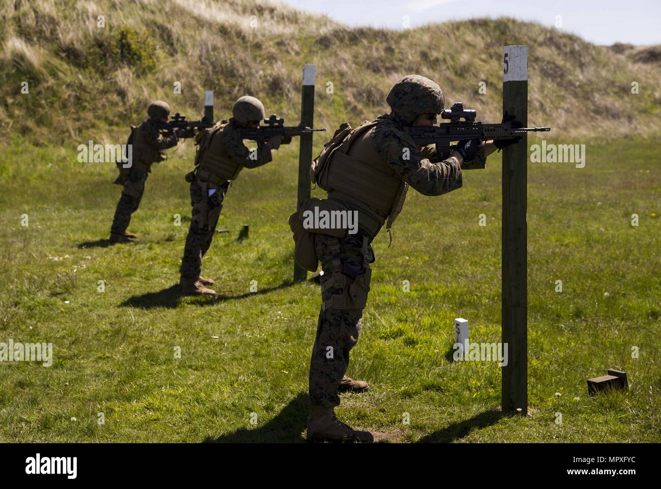 U.S. Marines with Marksmanship Training Company, Weapons Training Battalion, conduct shooting drills with a SA80 A2 assault rifle during the Royal Marine Operational Shooting Competiton (RMOSC) at Altcar Training Camp, Hightown, United Kingdom, May 15, 2018, May 15, 2018. The U.S. Marine Corps travels to the United Kingdom annually to compete in the (RMOSC) with the opportunity to exchange operational experiences, physical and markmanship training. (U.S. Marine Corps photo by Cpl. Robert Gonzales). () - Stock Image