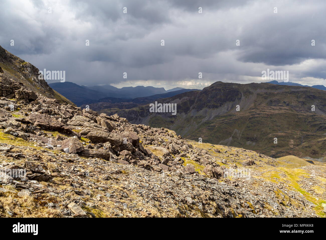 The summit of Cnicht can be seen across the Croesor valley from the side of Moelwyn Mawr while rain clouds start to move in. Stock Photo