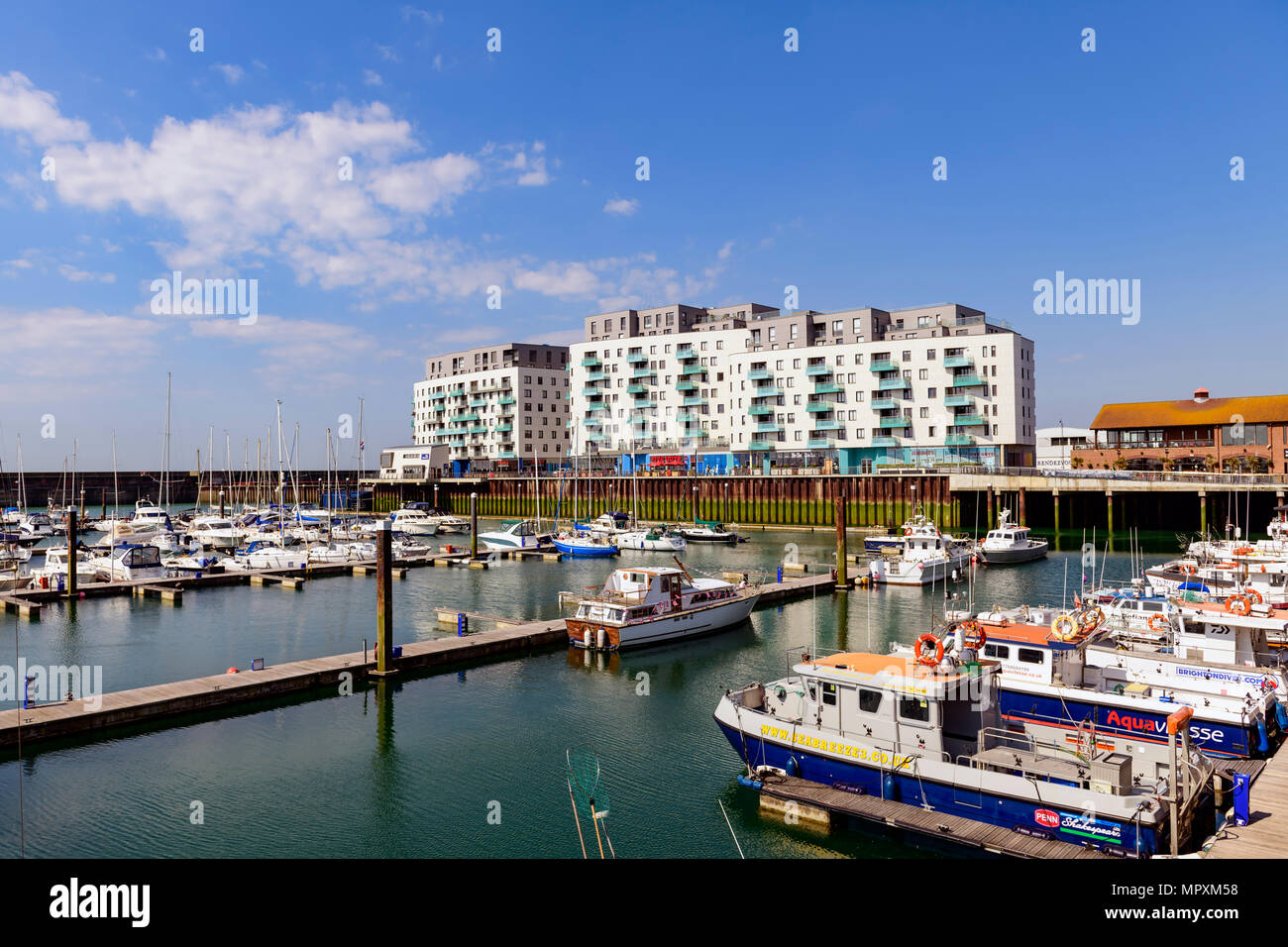 moored yachts and apartments, Brighton marina, Sussex UK - Stock Image