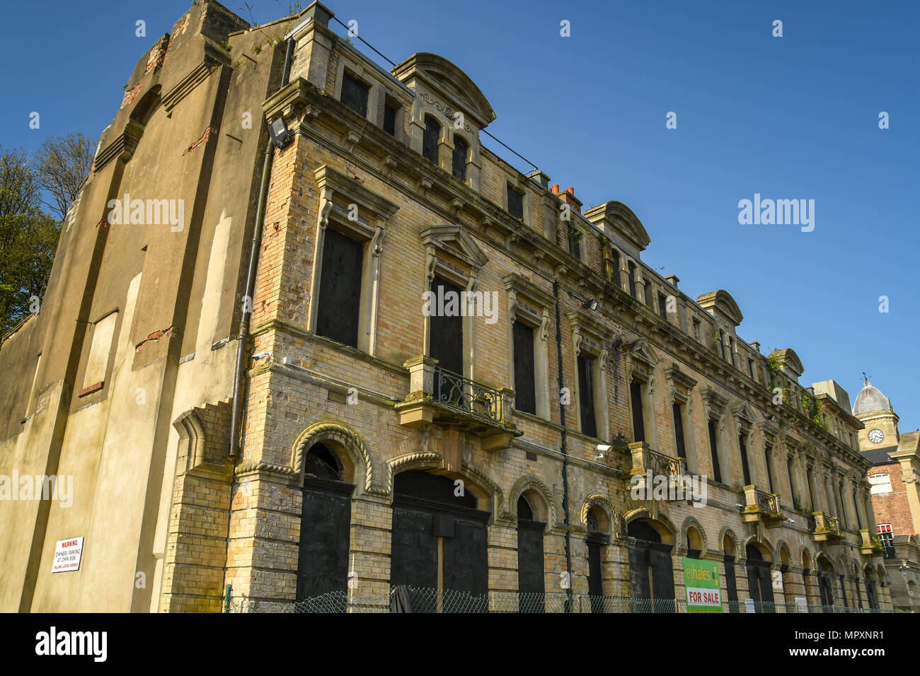 The derelict Marine Buildings near Penarth Marina and the Cardiff Bay barrage. It is Grade II listed. - Stock Image