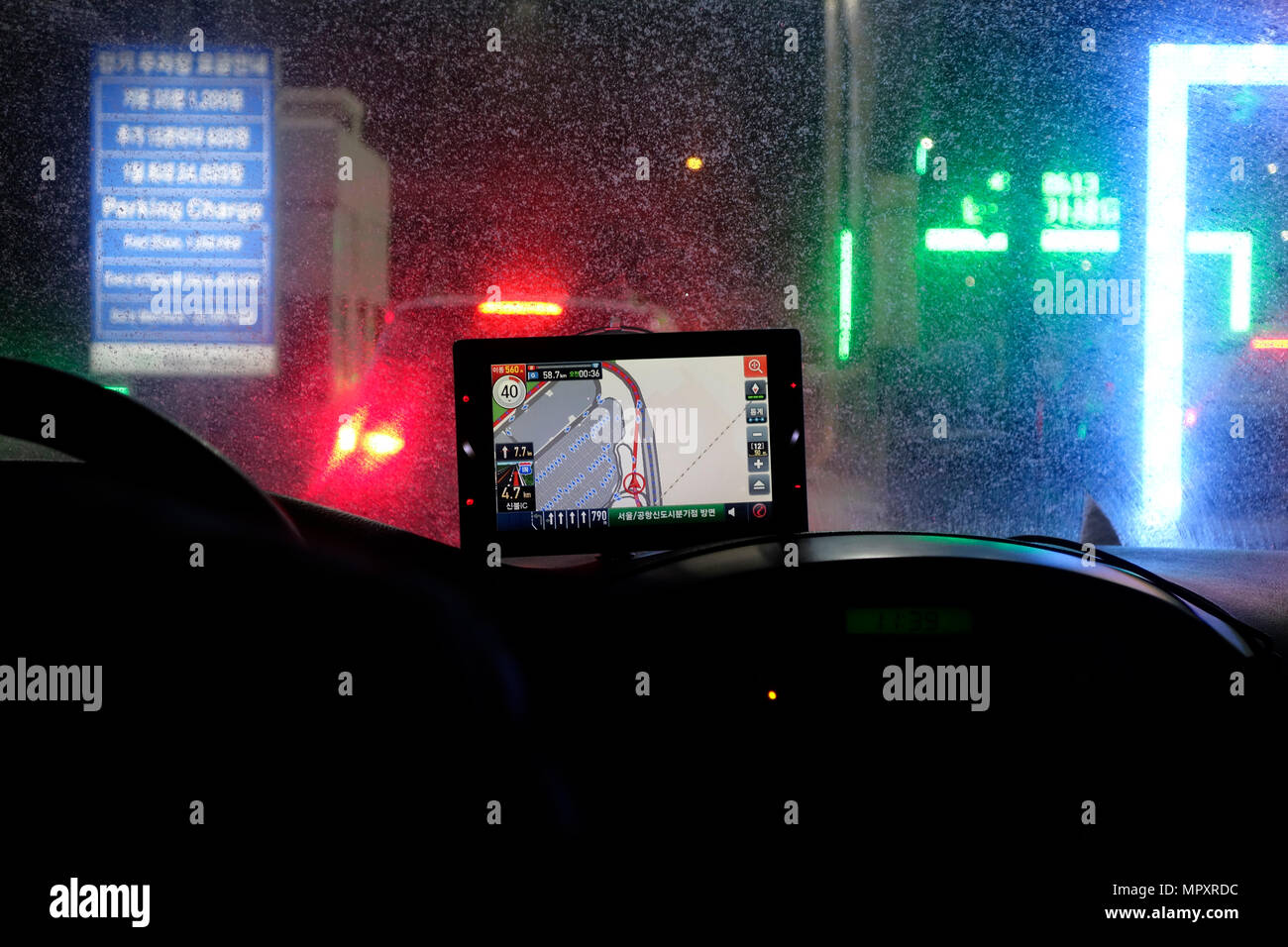 Satellite navigation car system showing live traffic information at night in the city of Seoul capital of South Korea - Stock Image