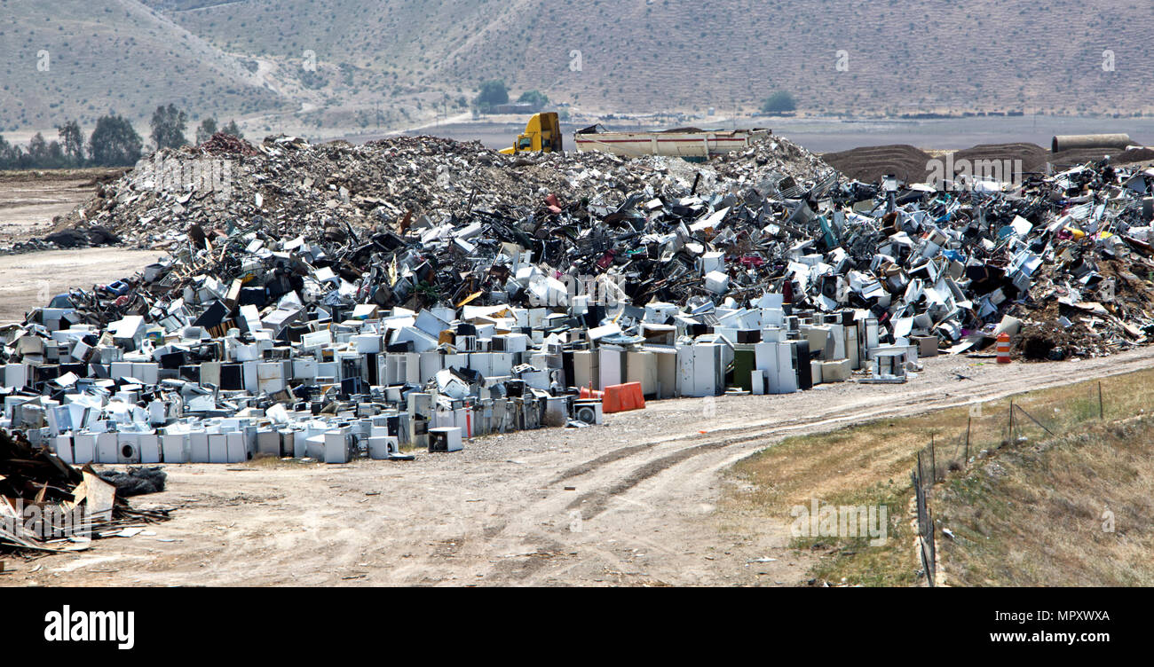 Recycling scrap metals, including discarded appliances such as refrigerators, diswashers, freezers,  stoves & etc. - Stock Image