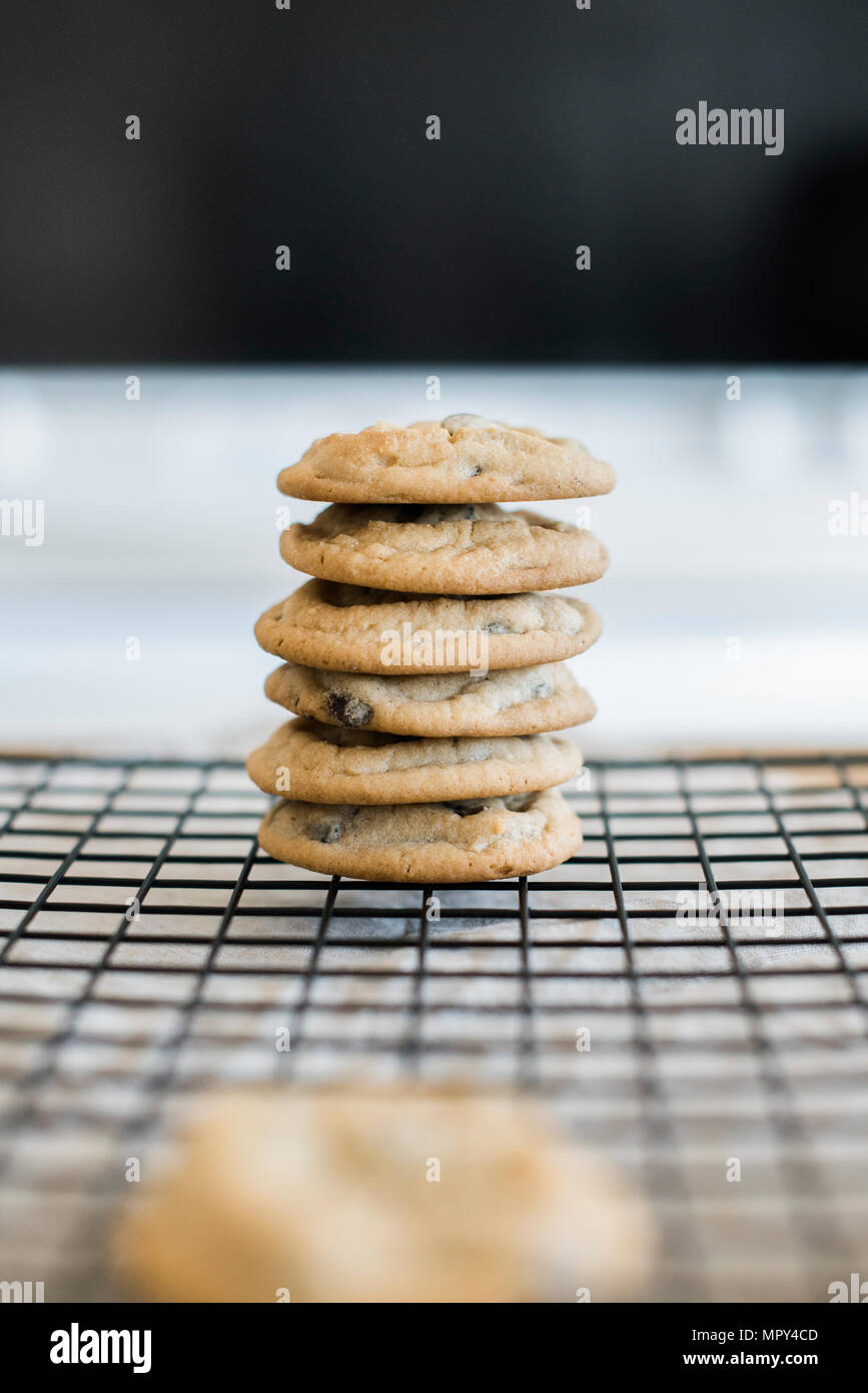 Stack of cookies on cooling rack - Stock Image