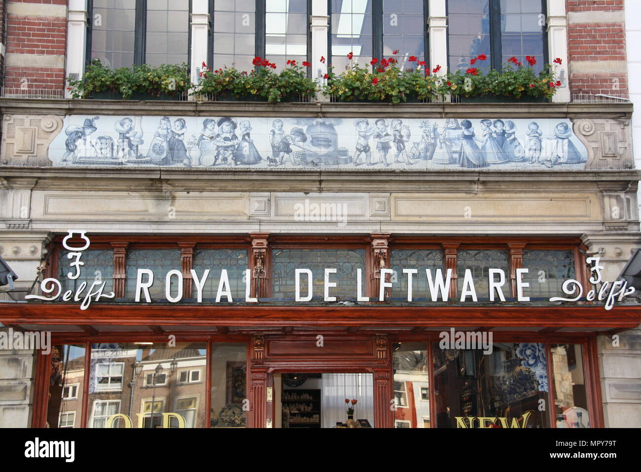 A shop selling delftware dutch pottery and souvenirs in Delft, the Netherlands. - Stock Image