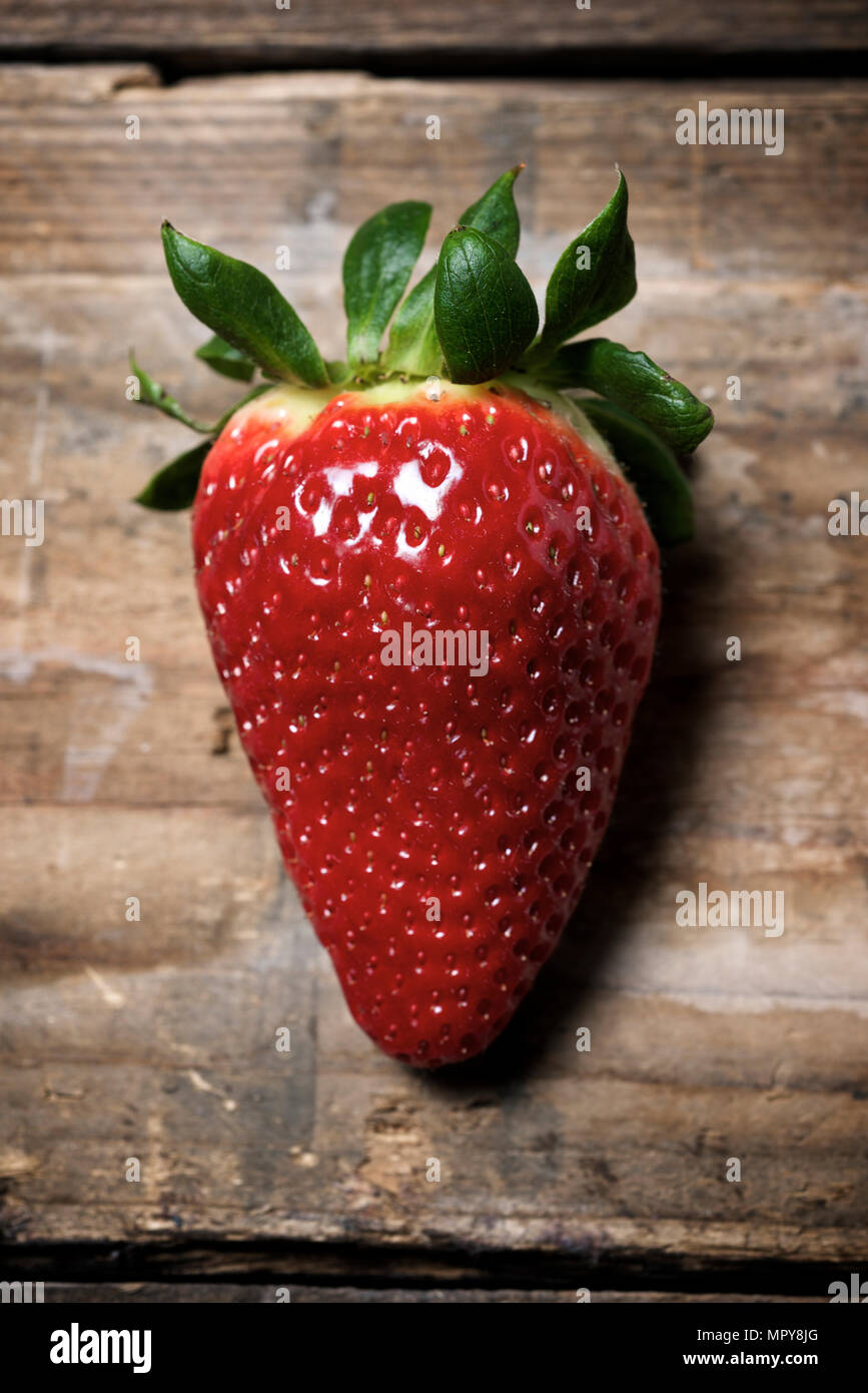 Close-up of strawberry on wooden table - Stock Image