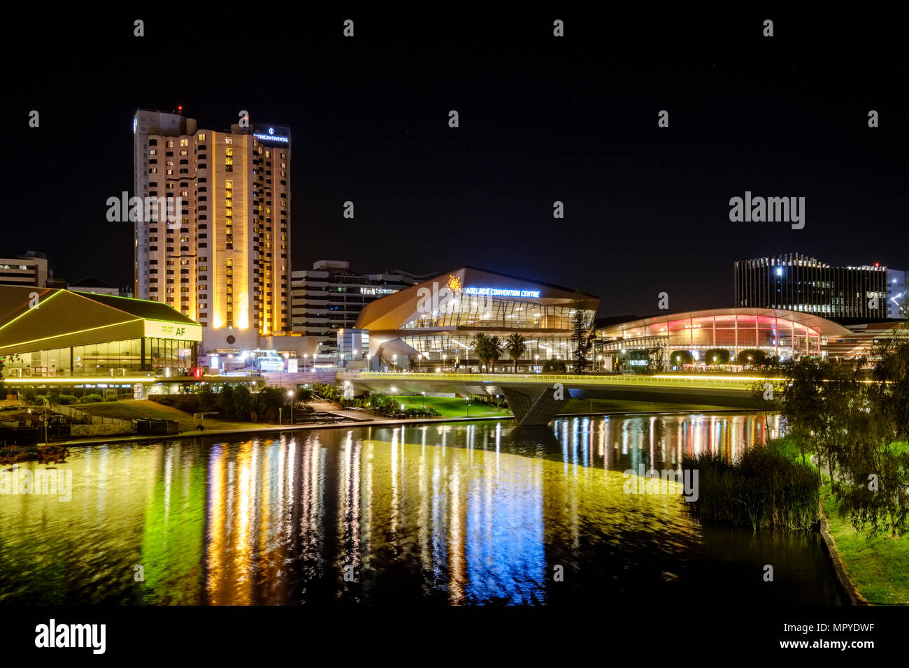 The Adelaide city skyline at night featuring the Torrens Riverbank precinct - Stock Image
