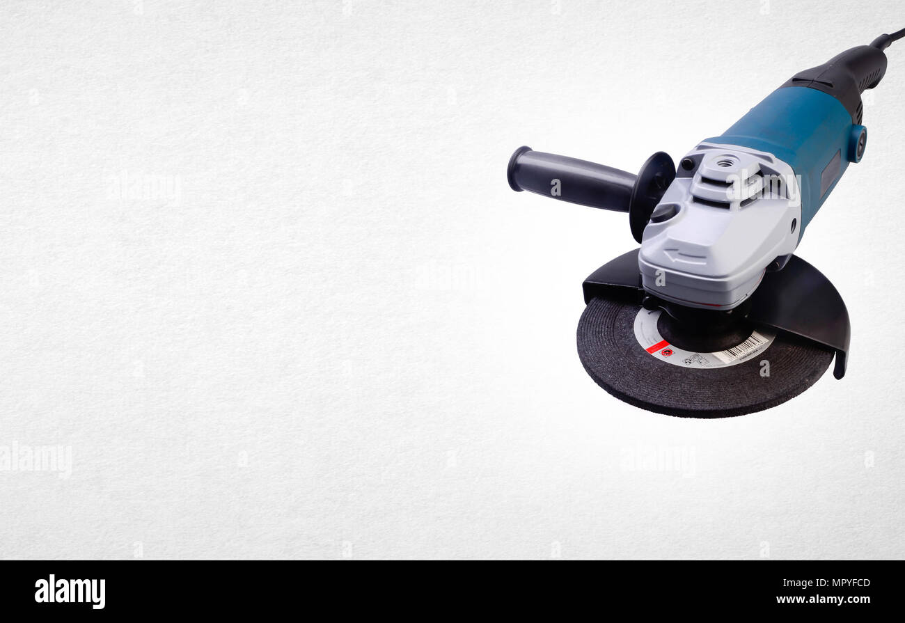 Electric grinder mechanic or angle grinder on background - Stock Image