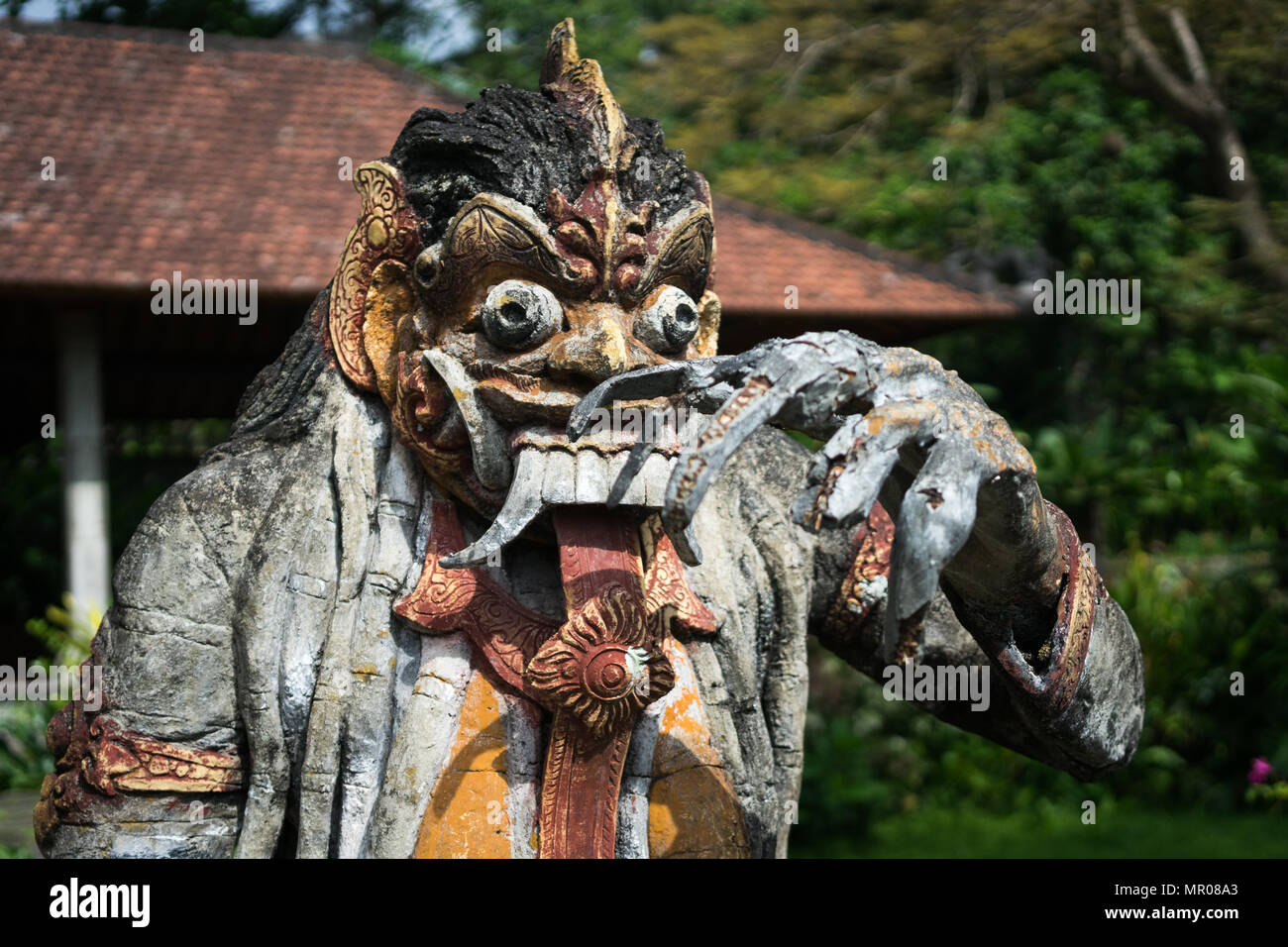 Frightening hindu wooden statue found at the tirta gangga water palace in Karangasem, Bali, Indonesia (17.05.2018) - Stock Image