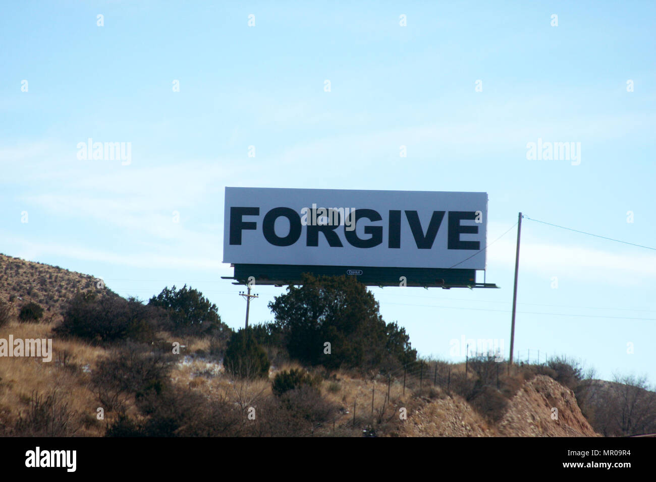Large banner with the word FORGIVE written on it - Stock Image