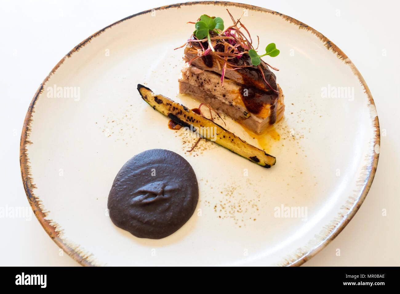 Pork belly, one item in the Merchanta Comedor tasting menu in San Miguel de Allende, Mexico - Stock Image
