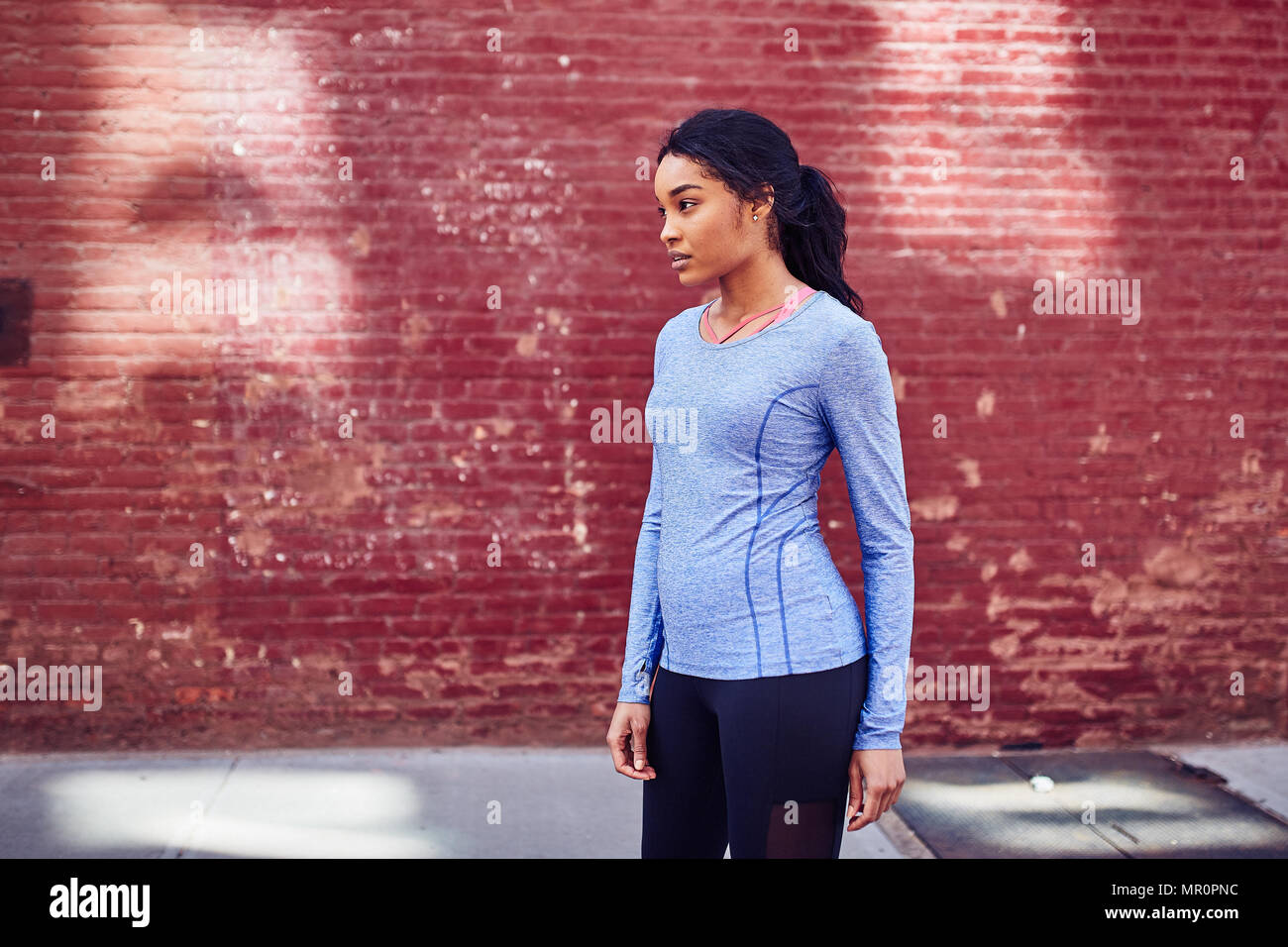Black woman rests after running Stock Photo