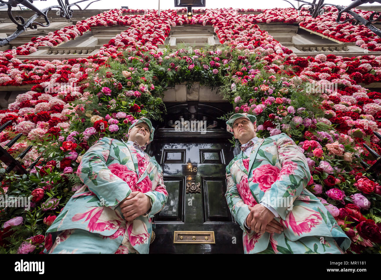 London, UK. 25th May 2018. Doormen dressed in floral pattern suits stand on duty outside of Annabel's private members club, adorned with thousands of flowers, timed to coincide with the RHS Chelsea Flower Show, in Mayfair Credit: Guy Corbishley/Alamy Live News - Stock Image