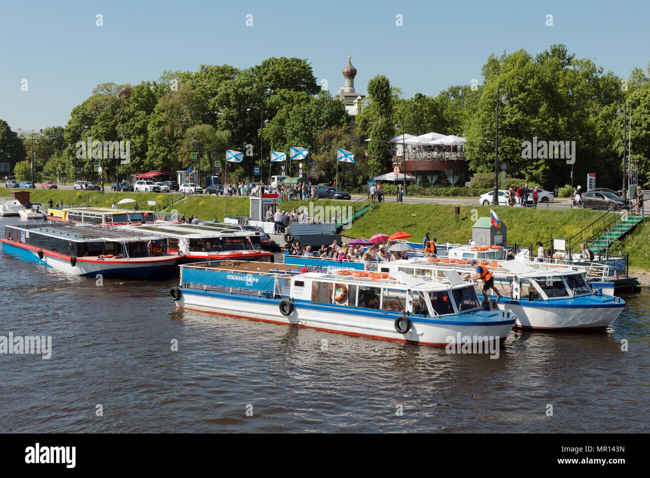 St. Petersburg, Russia, 25th May, 2018. People on tour boats at Zayachy island in the first day of school vacation. Boat tours is a favorite leisure activity for locals and tourists, children and adults - Stock Image