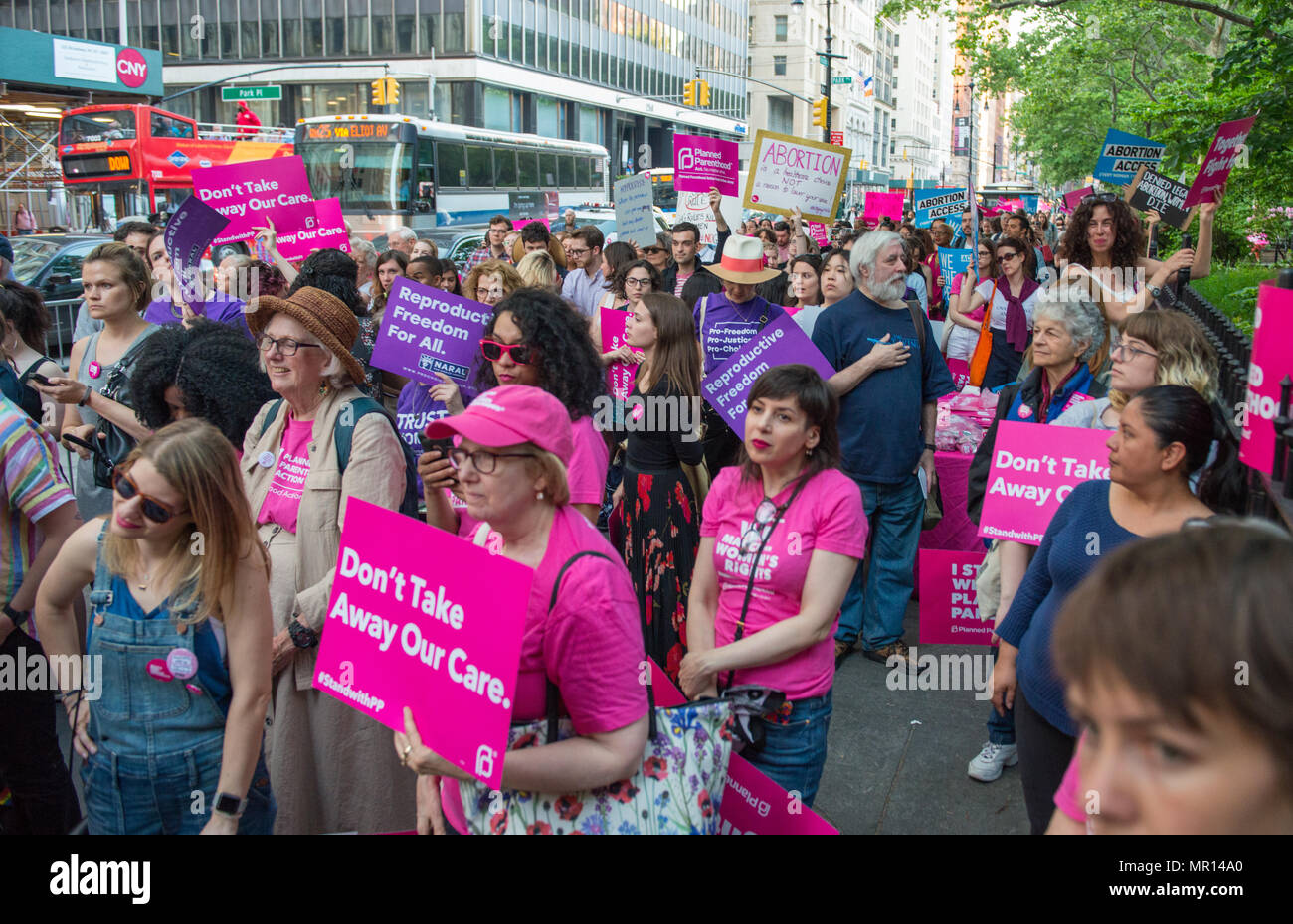 Supporters with signs at a Title X (Title Ten) gag rule rally in New York City, hosted by Planned Parenthood of New York City on May 24th 2018, reacting the President Trump's attempt to ban Medicaid and federal funding to medical providers who provide full, legal medical information to patients wanting or needing abortion services. - Stock Image