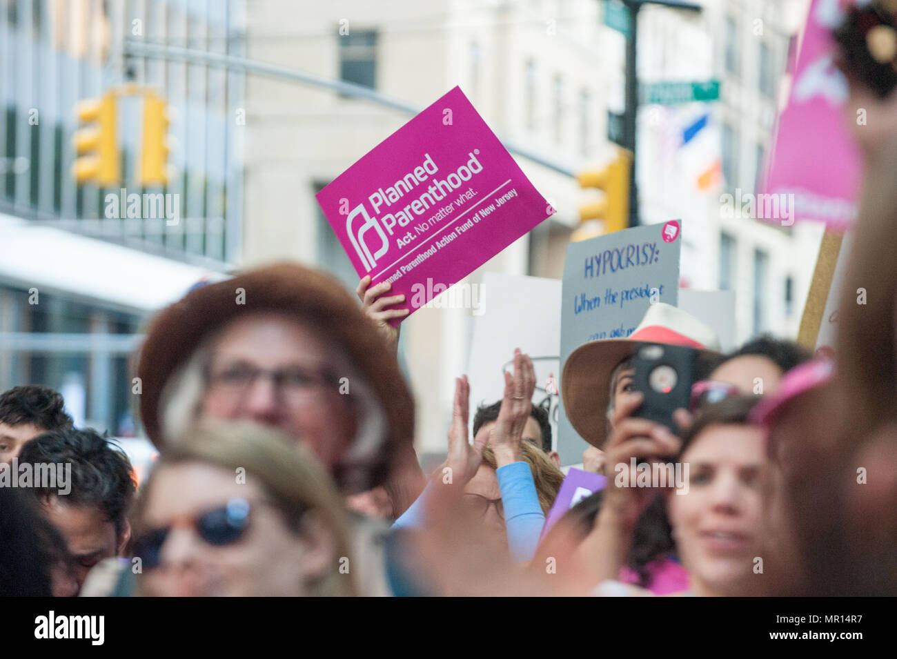 Supporters with protest signs at Title X (Title Ten) gag rule rally in New York City, hosted by Planned Parenthood of New York City on May 24th 2018, reacting the President Trump's attempt to ban Medicaid and federal funding to medical providers who provide full, legal medical information to patients wanting or needing abortion services. - Stock Image