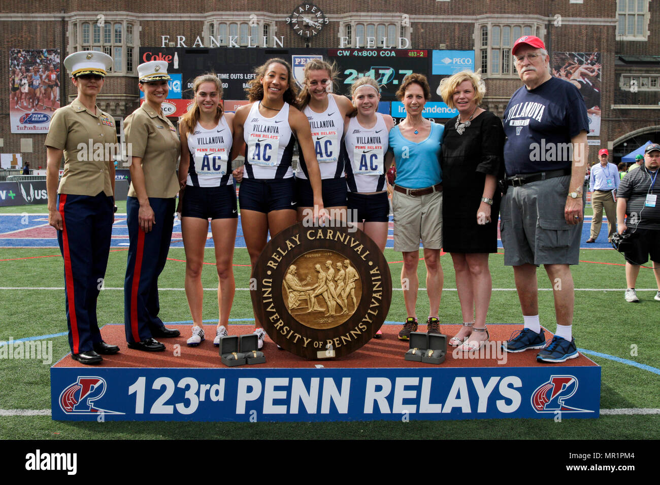 U.S. Marines present awards to the winners of the college women's 4x800 Champions of America Invitational during the 2017 Penn Relays in Philadelphia, April 29. The winners of the race are from Villanova University. The Penn Relays are the world's largest relay meet which has drawn crowds over 100,000 strong each year for the last decade. - Stock Image