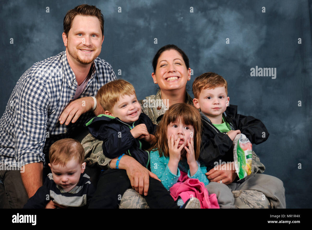 The Christi family poses for a photo at Joint Base Andrews, Md., April 27, 2017. Michael Christi, far right, son of Jeff Christi and Maj. Rebecca Christi, 779th Medical Group pediatrician, has autism spectrum disorder. The Air Force provides Michael with health and educational services, including Exceptional Family Member Program and Extended Care Health Options, which in turn provide therapies such as applied behavior analogy, speech therapy, and occupational therapy. April is also Autism Awareness Month, which is meant to increase understanding and acceptance of autism. (U.S. Air Force photo - Stock Image