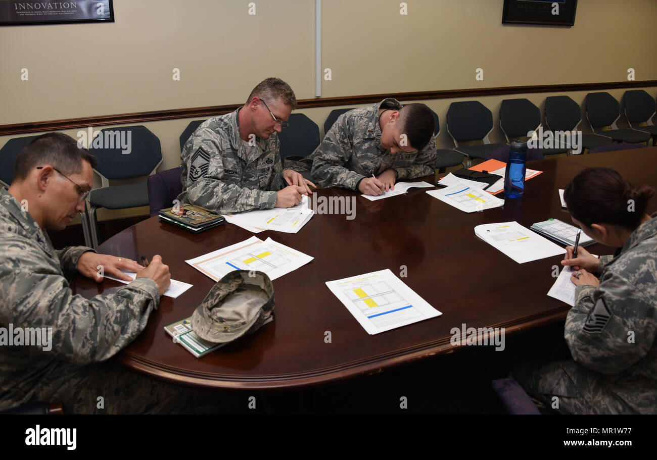 70th Intelligence, Surveillance and Reconnaissance Wing leadership and Air Force Assistance Fund project officers, sign their AFAF pledge form, April 7, 2017 at Fort Meade, Md. The AFAF is an annual effort to raise funds for the charitable affiliates that provide support to the Air Force family in need (active duty, retirees, reservists, guard and dependents, including surviving spouses. The charitable affiliate organizations provide support in an emergency, with educational needs, or a secure retirement home for widows or widowers of Air Force members in need of financial assistance. (U.S. Ai - Stock Image