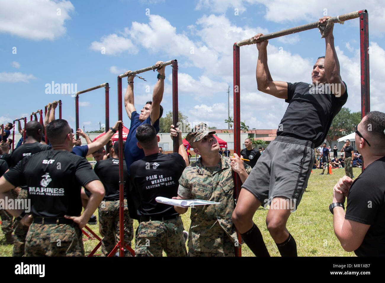 future marines participate in the pull up portion of the spartan