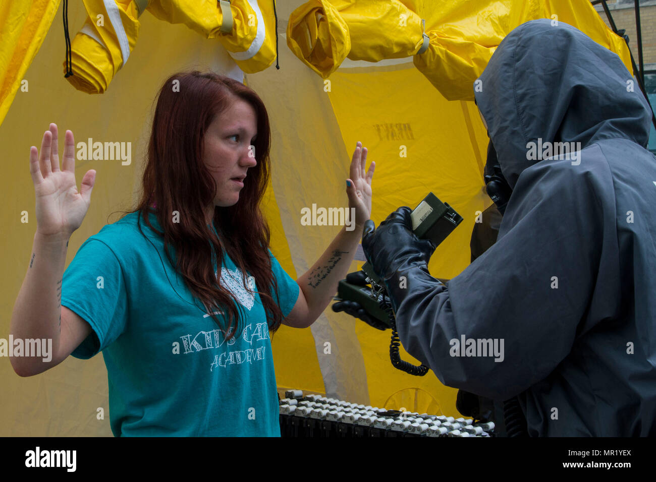 Civilian role player Cheyenne Patton, a North Vernon, Ind., resident, goes through decontamination following a mock nuclear disaster at the Muscatatuck Urban Training Center, April 28, 2017. The U.S. Army Reserve's Guardian Response 2017 is a multi-component training exercise designed to validate more than 4,000 service members in Defense Support of Civil Authorities in the event of a Chemical, Biological, Radiological and Nuclear catastrophe. This year's exercise simulated an improvised nuclear device explosion with a source region electromagnetic pulse out to more than four miles. The 84th T - Stock Image