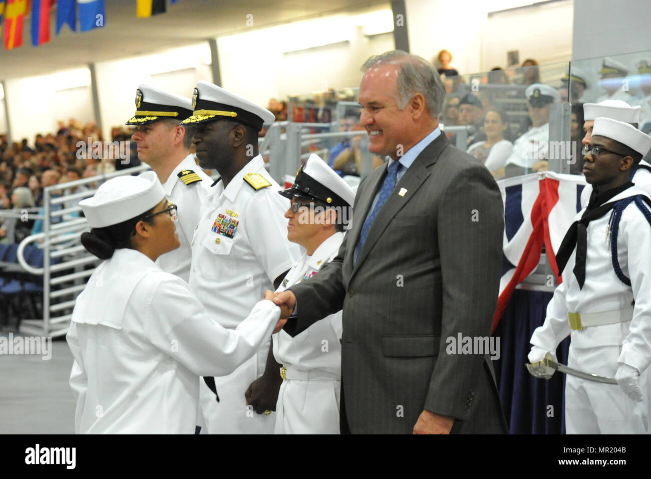 170428-N-CM124-303  GREAT LAKES, Il. (April. 28, 2017) Ryne Sandberg, a former Chicago Cubs and Philadelphia Phillies major league baseball (MLB) player and member of MLB Hall of Fame, was the guest of honor during a boot camp graduation ceremony at Recruit Training Command. Sandberg attended the graduation as a guest of Rear Adm. Stephen Evans, commander, Naval Service Training Command, pictured second from left. Approximately 30,000-40,000 recruits graduate annually from the Navy's only boot camp. (U.S. Navy photo by Susan Krawczyk/Released) - Stock Image