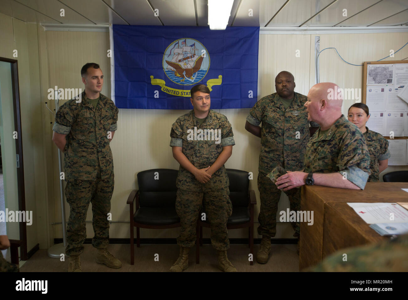 Major Gen. Walter L. Miller Jr., commanding general of II Marine Expeditionary Force, speaks with hospital corpsmen assigned to Special Purpose Marine Air-Ground Task Force-Crisis Response-Africa at Moron Air Base, Spain, April 27, 2017. SPMAGTF-CR-AF deployd to conduct limited crisi response and theater security operations in Europe and North Africa. (U.S. Marine Corps photo by Staff Sgt. Kenneth Trotter) - Stock Image