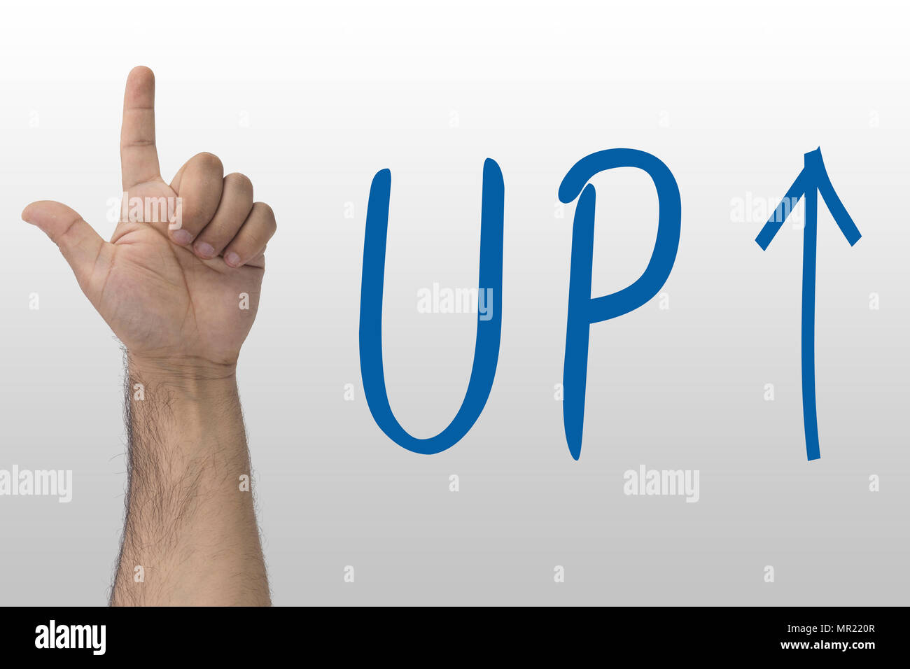 Hand gesture show up. UP text with an up arrow. hand sign upstairs. Hand pointing upwards on whiteboard with text Up Stock Photo
