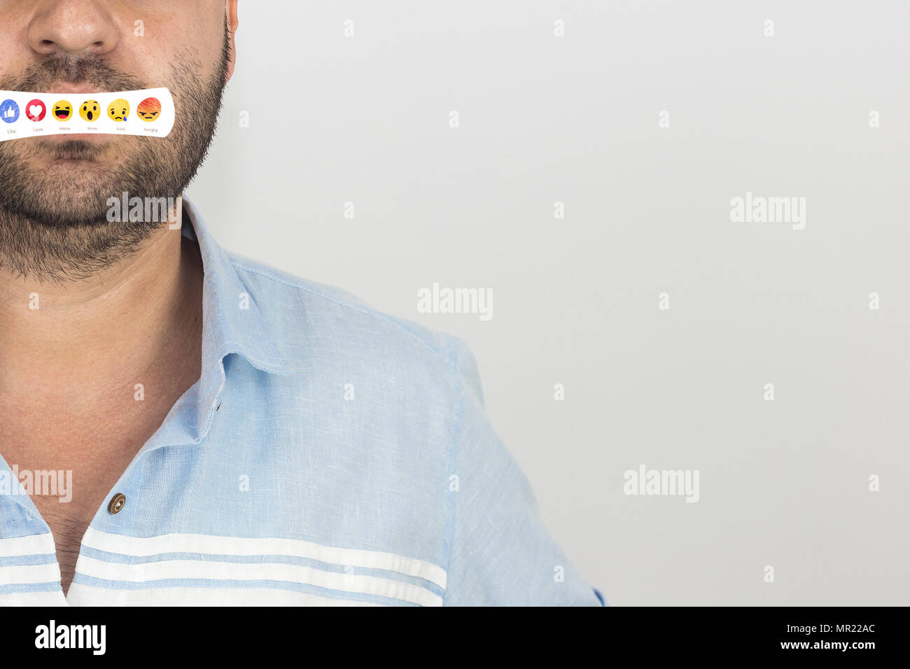 Part of male face with set of emoticons and copy space for text. - Stock Image