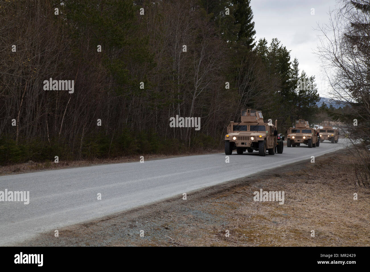 U.S. Marines with 2nd Transportation Support Battalion, Combat Logistics Regiment 2, 2nd Marine Logistics Group move a convoy of Humvees as part of Strategic Mobility Exercise 17 (STRATMOBEX) in Frigaard, Norway, May 3, 2017. STRATMOBEX was conducted to analyze the responsiveness of the force for future contingency operations involving the Marine Corps Prepositioning Program in Norway (MCPP-N).  MCPP-N creates strategic options for the defense of NATO allies and partners by providing regional support. (U.S. Marine Corps photo by Cpl. Emily Dorumsgaard) Stock Photo