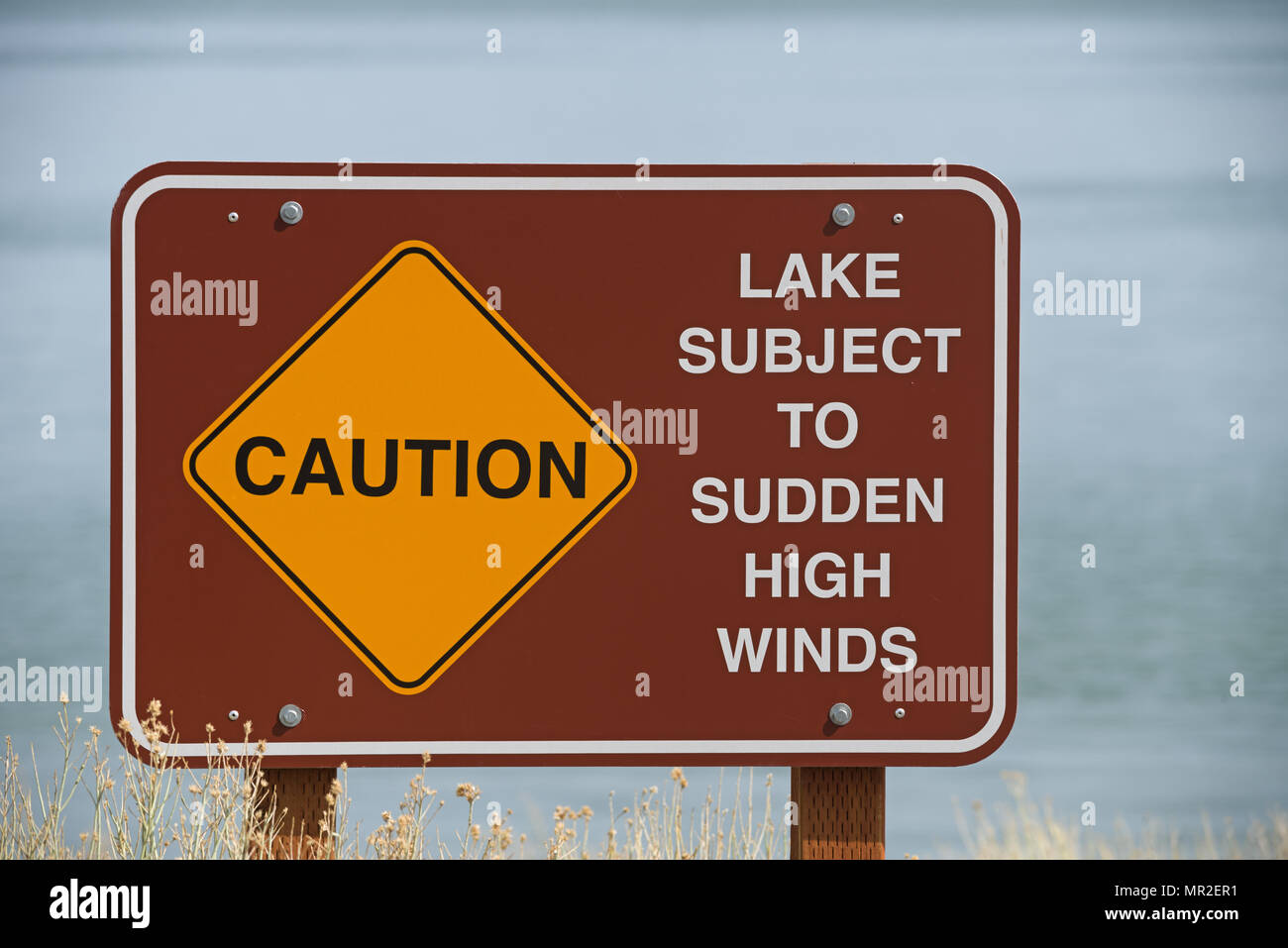 caution lake subject to high winds sign on the shore of Mono Lake - Stock Image