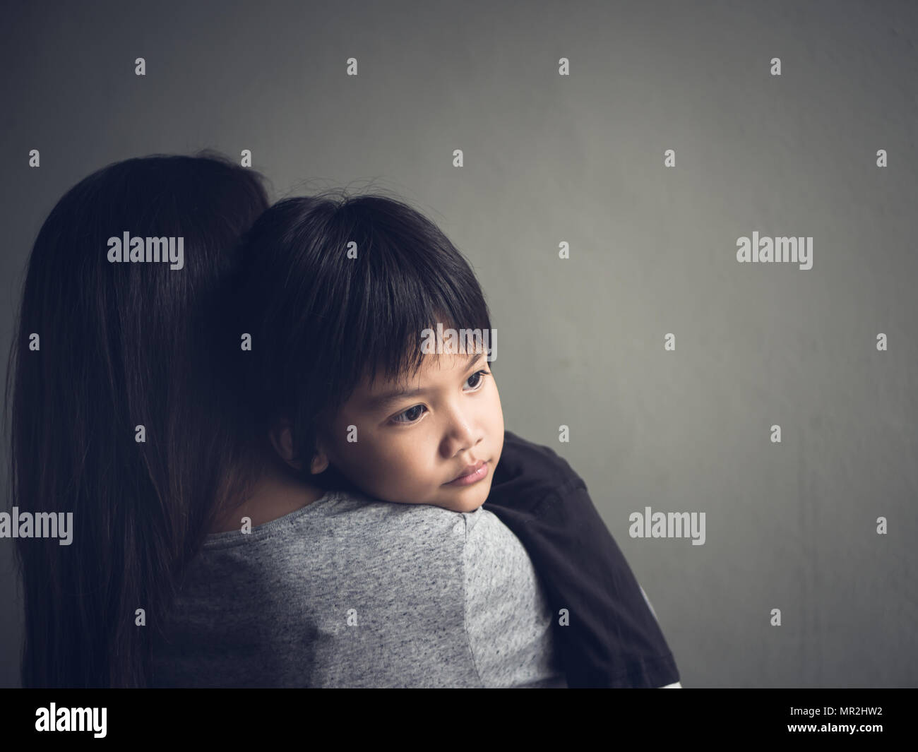 Closeup Sad Little Boy Being Hugged By His Mother At Home Parenthood Love And Togetherness Concept Stock Photo Alamy