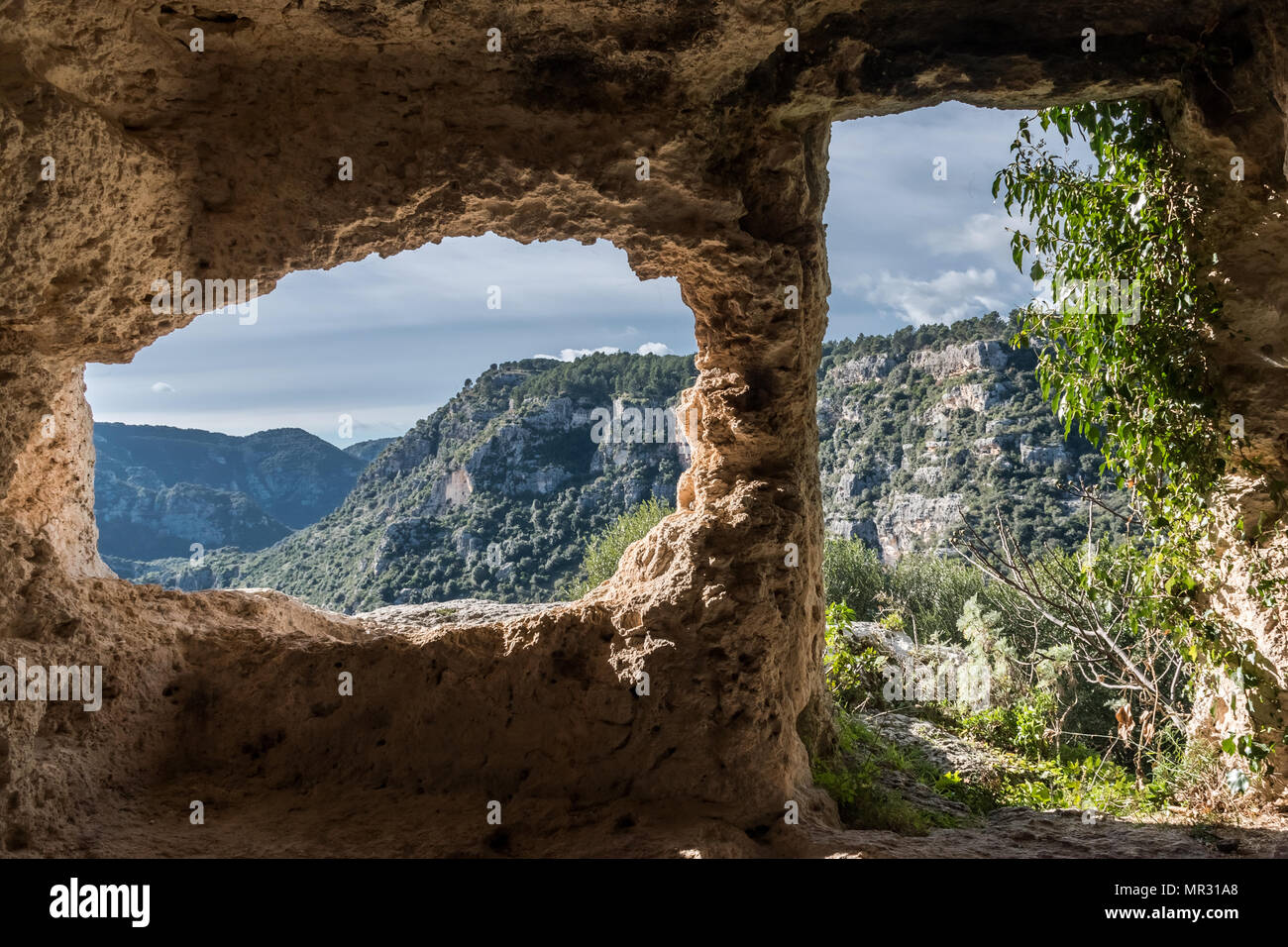 Interior of a tomb in Pantalica, a necropolis in Sicily - Stock Image