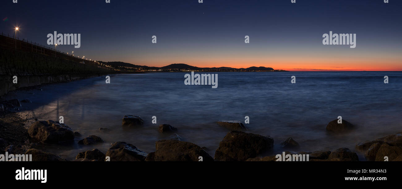 Panoramic view of Colwyn Bay at dusk on the North Wales coast - Stock Image